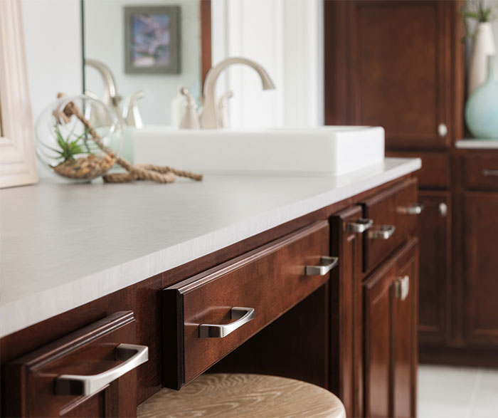 Close-up of dark Maple bathroom cabinets