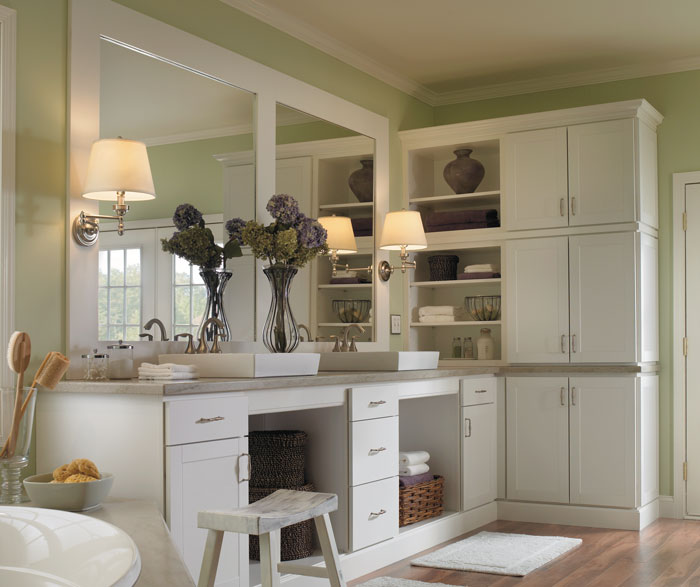 White bathroom cabinets by Aristokraft Cabinetry