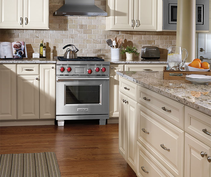 ivory cabinets in traditional kitchen by aristokraft cabinetry     three drawer base cabinet   aristokraft cabinetry  rh   aristokraft com