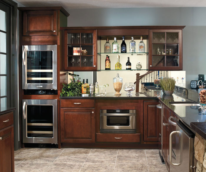 Dark Maple cabinets in casual kitchen by Aristokraft Cabinetry