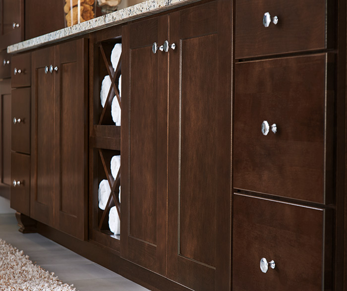 Close up of dark wood Korbett cabinets in a transitional bathroom