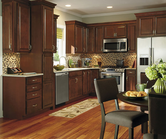 Dark wood kitchen cabinets aristokraft cabinetry for Dark wood kitchen units