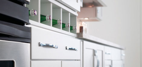 Close up of white maple kitchen cabinets with organizers