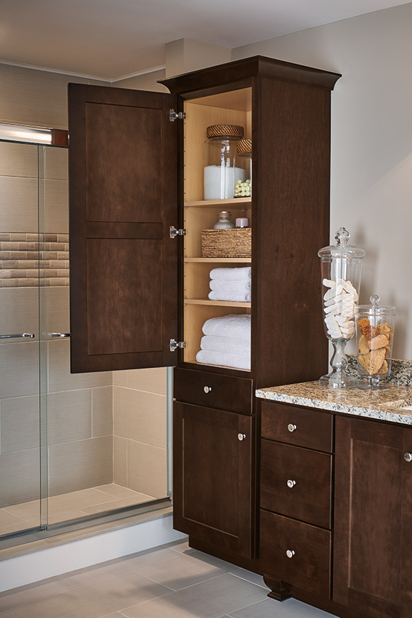 Linen closet cabinet in Maple Umber