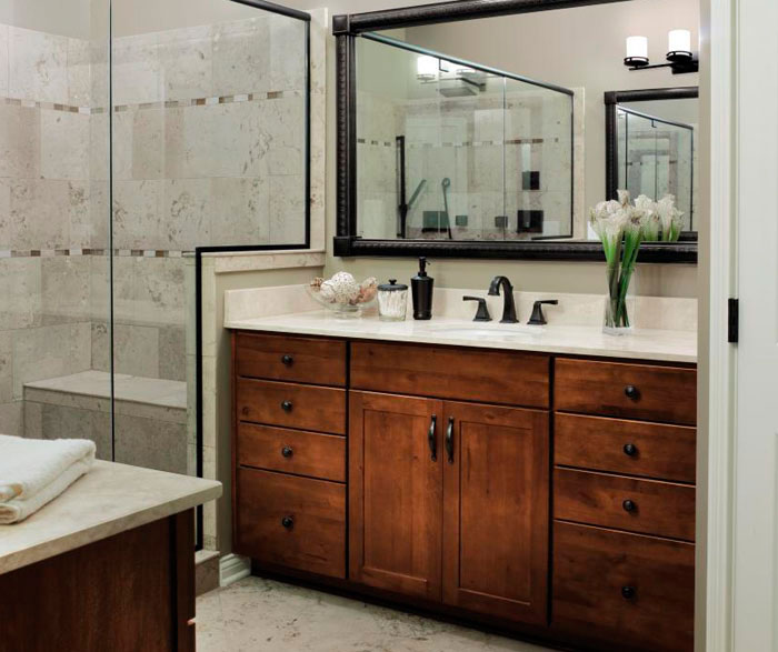 Rustic cabinets in bathroom by Aristokraft Cabinetry