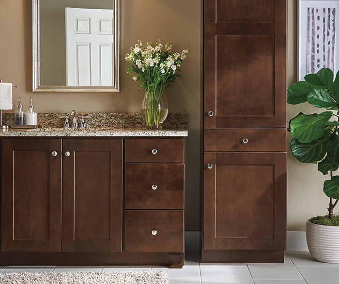 Dark wood Korbett cabinets in a transitional bathroom
