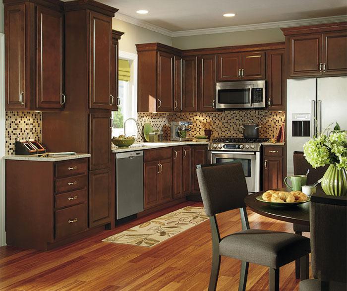 Dark wood kitchen cabinets by Aristokraft Cabinetry